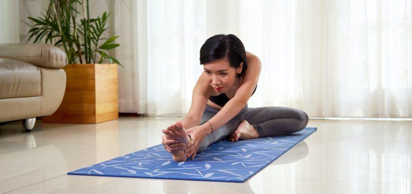 Woman bending to right leg